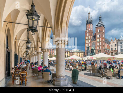 Krakow Old Town. View of St Mary's Basilica and the Main Square ( Rynek Główny ) from a cafe in the Cloth Hall (Sukiennice), Kraków, Poland - Stock Photo