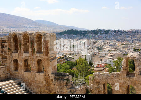 Ruins of ancient theater on the Acropolis with cityscape of Athenas. The Odeon of Herodes Atticus on the south slope of the Acropolis in Athens, Greec - Stock Photo