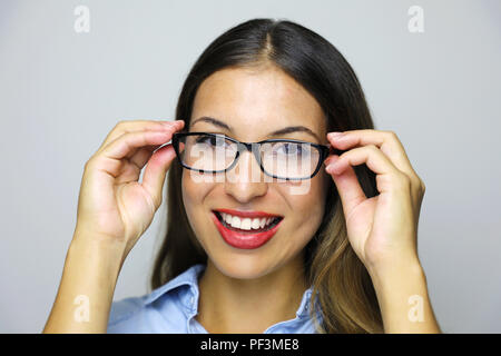 Beauty woman wearing eyeglasses posing looking at camera over gray background - Stock Photo