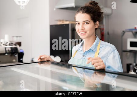Smiling Woman Working in Cafe - Stock Photo