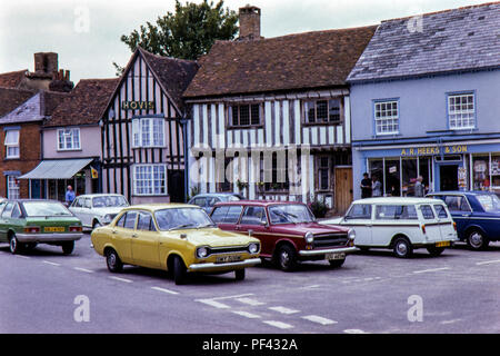 Period cars parked at Lavenham, Suffolk in August 1979 - Stock Photo