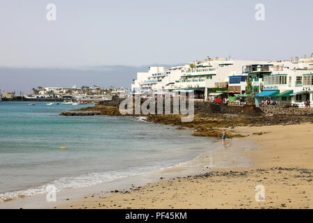LANZAROTE, SPAIN - APRIL 18, 2018: Beautiful view of Playa Blanca beach and village, Lanzarote, Canary Islands, Spain - Stock Photo