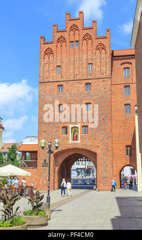 OLSZTYN, POLAND: Upper Gate in old town, called High Gate (polish: Brama Wysoka) - city gate existing since the 14th century - Stock Photo