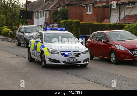 A West Midlands Police emergency response car, seen en route to an incident in the Birmingham area of the United Kingdom. - Stock Photo