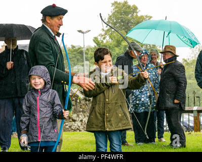 Haddington, UK. 19 August 2018.  The Royal Company of Archers, a ceremonial unit known as the Queen's Bodyguard For Scotland stages a clout archery shoot as part of Haddington 700 events taking place during 2018 to celebrate the granting of a charter by Robert the Bruce to the town in 1318, confirming Haddington's right to hold a market and collect customs. Children had a chance to practise archery with bows and arrows - Stock Photo