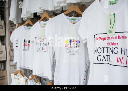 Notting Hill Gate -  T-shirts on display in a shop on Portobello Road, London, UK - Stock Photo