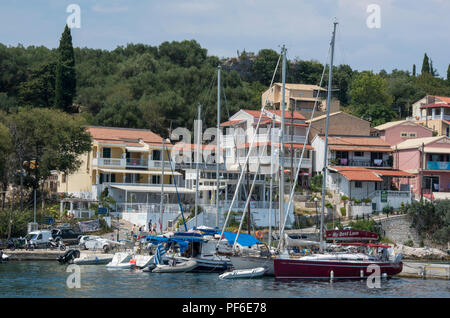 yachts and boats moored in the picturesque harbour at kassiopi on the  greek island of corfu in greece. - Stock Photo