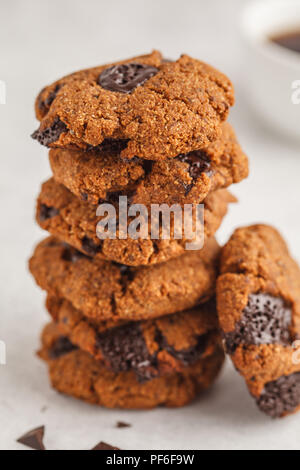Stack of healthy vegan cookies with chocolate. Clean eating concept. - Stock Photo