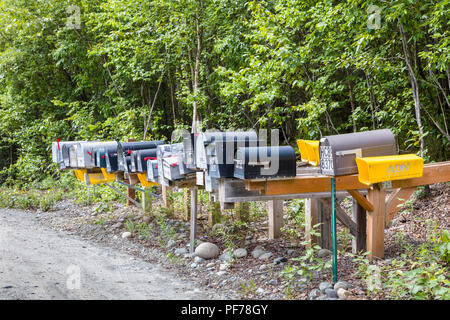 Line of mailboxes along side road - Stock Photo