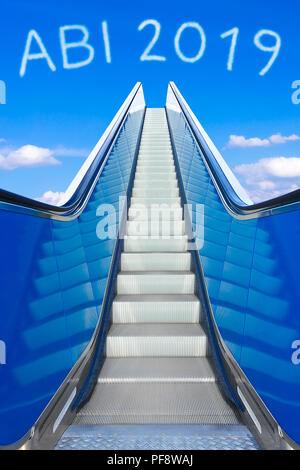 Escalator into a blue sky, concept of achievement, ABI 2019 text, Abitur meaning german high school graduation or A levels - Stock Photo