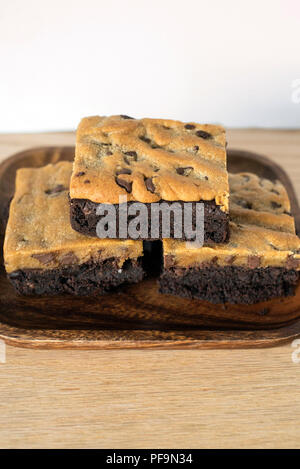 Brookie Brownie Cookie Dessert Combo Stacked on a Wooden Plate for a Treat - Stock Photo