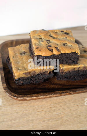 Tempting Treat of 3 Brookie Brownie Cookie Bars Piled on a Plate - Stock Photo