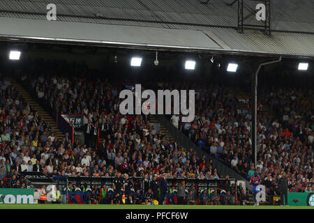 Fans watch on from behind the managers benches - Crystal Palace v Liverpool, Premier League, Selhurst Park, London (Selhurst) - 20th August 2018 - Stock Photo