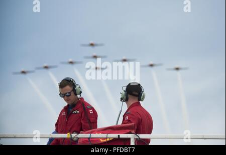 The Royal Canadian Air Force Snowbirds fly in formation over the heads of team members in the announcer's stand during the Thunder of Niagara International Air Show, June 9, 2018, Niagara Falls Air Reserve Station, N.Y. - Stock Photo