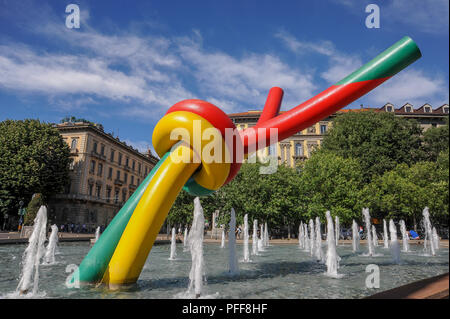 Milan Italy June 2, 2010: colored sculpture with a multicolored thread that emerges in the fountain at piazza Cadorna - Stock Photo