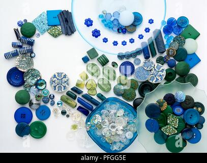 Blue and green buttons of various shapes and sizes - Stock Photo