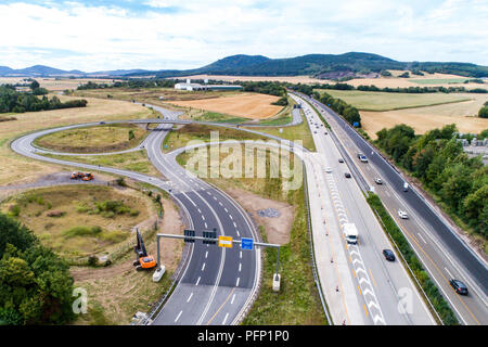 Aerial view of a highway intersection with a clover-leaf interchange in Germany Koblenz - Stock Photo