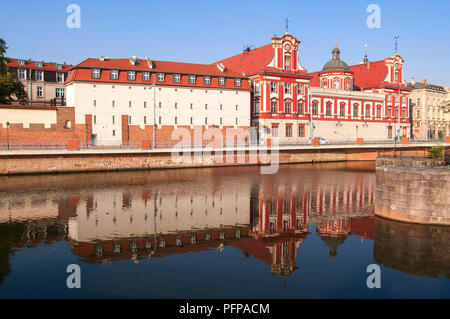 Wroclaw, Poland, August 2018.Ossolineum Library. With reflection in Odra River in the morning sun. - Stock Photo