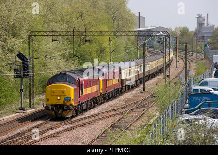 A pair of class 37 diesel locomotives numbers 37417 'Richard Trevithick' and 37401 working Pathfinder Tours 'The Grays Church Elegy' at Harlow Mill. - Stock Photo