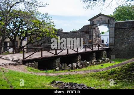 Wooden bridge and stone gate in the old part of Colonia del Sacramento - Stock Photo