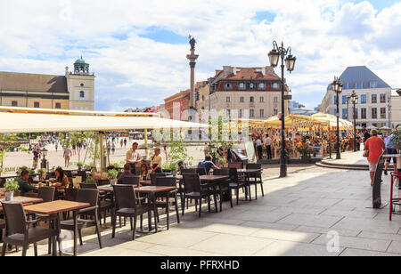 Afternoon at  Castle Square in Warsaw, view towards King Zygmunt's Column and  church of St. Anny and Krakowskie Przedmiescie stree - Stock Photo