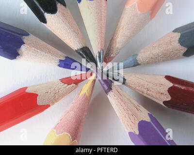 close up.colored pencils stacked in a circle on a white backgrou - Stock Photo
