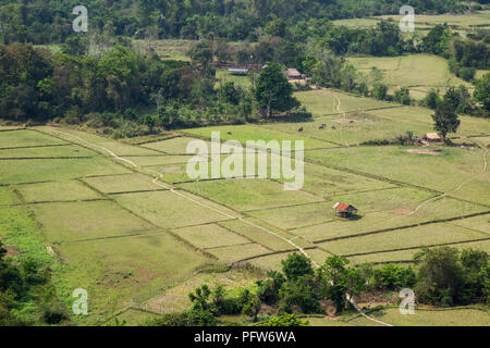 Beautiful view of fields and rice paddies from above near Vang Vieng, Vientiane Province, Laos, on a sunny day. - Stock Photo