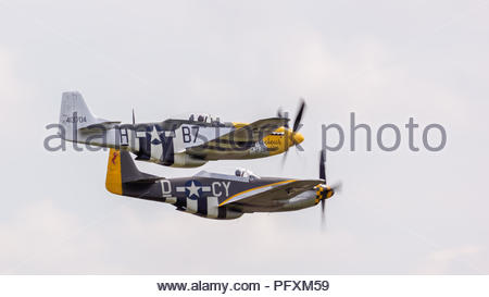 Mustang P-51D Ferocious Frankie and TF-51D Miss Velma  planes on flyby at Duxford Air Show - Stock Photo