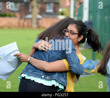 Manchester, UK. 23rd Aug, 2018. Tara Kinney in yellow, celebrates her GCSE results at Withington Girl's School, Manchester. Photograph by Credit: Howard Walker/Alamy Live News - Stock Photo