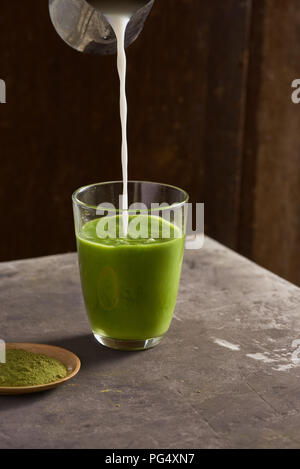 Matcha green tea latte in glass cup - Stock Photo