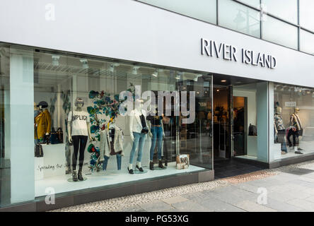 Shop windows with mannequins & clothes and entrance of the River Island fashion store in Kilmarnock, East Ayrshire, Scotland. - Stock Photo