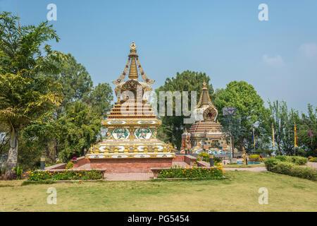 Beautiful Buddhist stupas in Kopan monastery Park, Kathmandu, Nepal. - Stock Photo