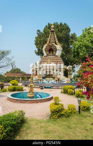 Stupa and the fountain in the Park of the Buddhist Kopan monastery, Kathmandu, Nepal. - Stock Photo