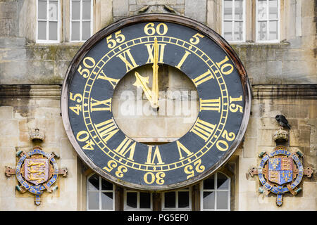 Clock showing eleven o'clock in the Great Court at Trinity college, Cambridge University, England. - Stock Photo