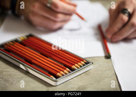 Close-up of artist drawing a sketch - Stock Photo