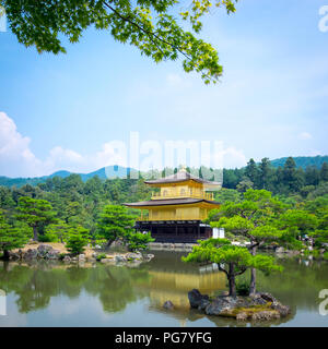 Kinkaku-ji (also known as Kinkakuji or Rokuon-ji), the Temple of the Golden Pavilion, is famous Zen Buddhist temple located in Kyoto, Japan. - Stock Photo