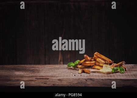 Hand made french fries with mayonnaise on wood - Stock Photo