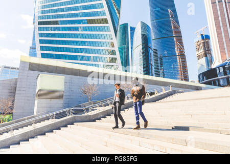 Russia, Moscow, two businessmen with coffee to go in the city - Stock Photo