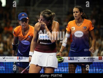 Spanish padel players Gemma Tray (R), and her teammate Lucia Sanz (L) are worried after Alejandra Salazar (C) was hit by the ball during their women's semifinal match of Worl Padel Tour's Vallbanc Andorra la Vella Open tournament in Andorra, 25 August 2018. The tournament runs from 20 to 26 August. EFE/Fernando Galindo - Stock Photo