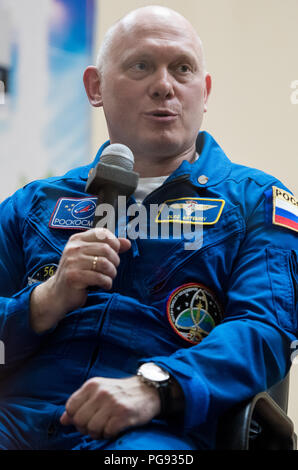 Expedition 55 Soyuz Commander Oleg Artemyev of Roscosmos answers a question during a press conference, Tuesday, March 20, 2018 at the Cosmonaut Hotel in Baikonur, Kazakhstan. Artemyev, flight engineer Ricky Arnold and flight engineer Drew Feustel of NASA are scheduled to launch to the International Space Station aboard the Soyuz MS-08 spacecraft on Wednesday, March, 21. - Stock Photo