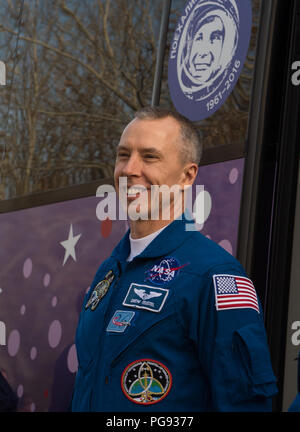 Expedition 55 Soyuz flight engineer Drew Feustel of NASA is seen as he and fellow crewmates Oleg Artemyev of Roscosmos and Ricky Arnold of NASA depart the Cosmonaut Hotel to suit-up for their Soyuz launch to the International Space Station, Wednesday, March 21, 2018 in Baikonur, Kazakhstan. Arnold, Artemyev, and Feustel launched aboard the Soyuz MS-08 spacecraft at 1:44 p.m. Eastern time (11:44 p.m. Baikonur time) on March 21 to begin their journey to the International Space Station. - Stock Photo