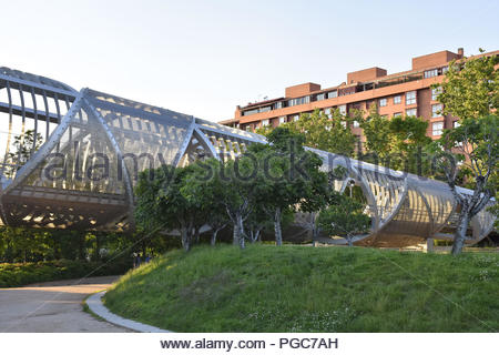 Puente de Arganzuela - modern footbridge, steel landmark structure and park in Madrid Spain Europe. Designed by French architect Dominique Perrault. - Stock Photo