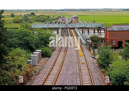 Reedham Swing Bridge in the open position to allow boat traffic through on the River Yare at Reedham, Norfolk, England, United Kingdom, Europe. - Stock Photo