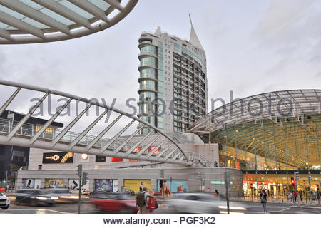 Vasco da Gama shopping center and St Rafael Tower - hi rise residential building at dusk in Parque das Nacoes district of Lisbon Portugal. - Stock Photo