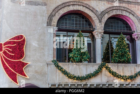 Hostaria dell'Orso at Christmas time with traditional decorations and lights. Big red bow. Ancient 14th century building facade. Rome, Italy, Europe. - Stock Photo
