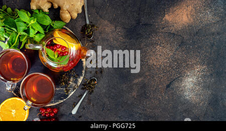 Top view of tea set on dark background - Stock Photo