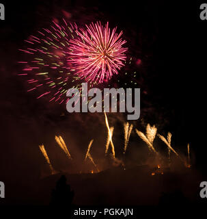 Princes Street Gardens, Edinburgh, Scotland, UK, 27th August 2018. Edinburgh International Festival finale Virgin Money sponsored fireworks. The Scottish Chamber Orchestra play selections from Holst's Suite The Planets choreographed with fireworks from Edinburgh Castle to end the Summer festival - Stock Photo