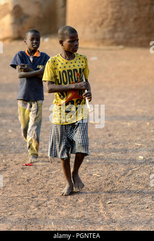DAGOMBA VILLAGE, GHANA - JAN 14, 2017: Unidentified Dagomban children walk in the local village. Dagombas are ethnic group of Northern Ghana - Stock Photo