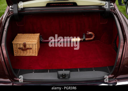 UK, England, Cheshire, inside boot of 1999 Bentley Arnage saloon car , with picnic basket and original umbrella - Stock Photo