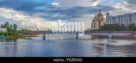 ASTANA, KAZAKHSTAN - JULY 3, 2016: Pedestrian bridge over the river Ishim - Stock Photo